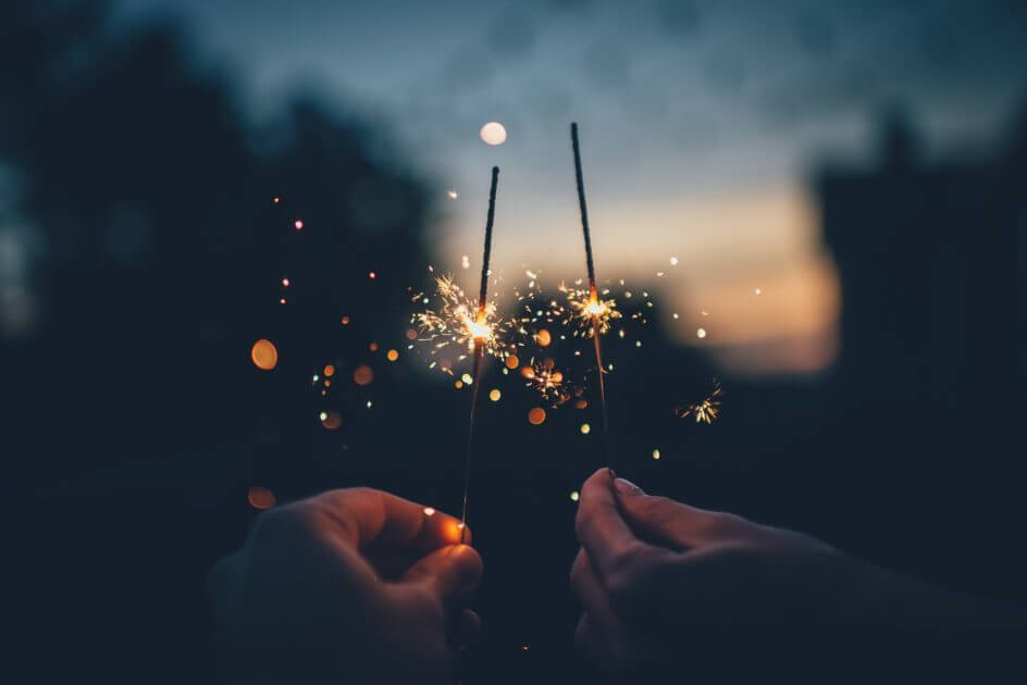 A couple holding sparklers
