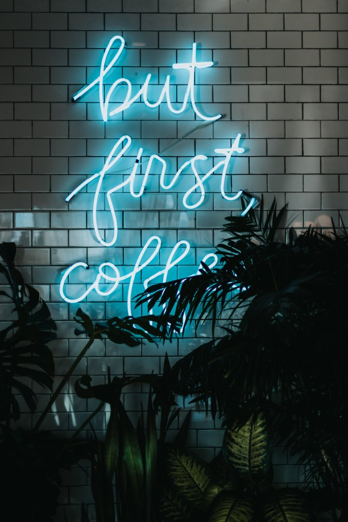 """A sign that says, """"But first, coffee"""""""