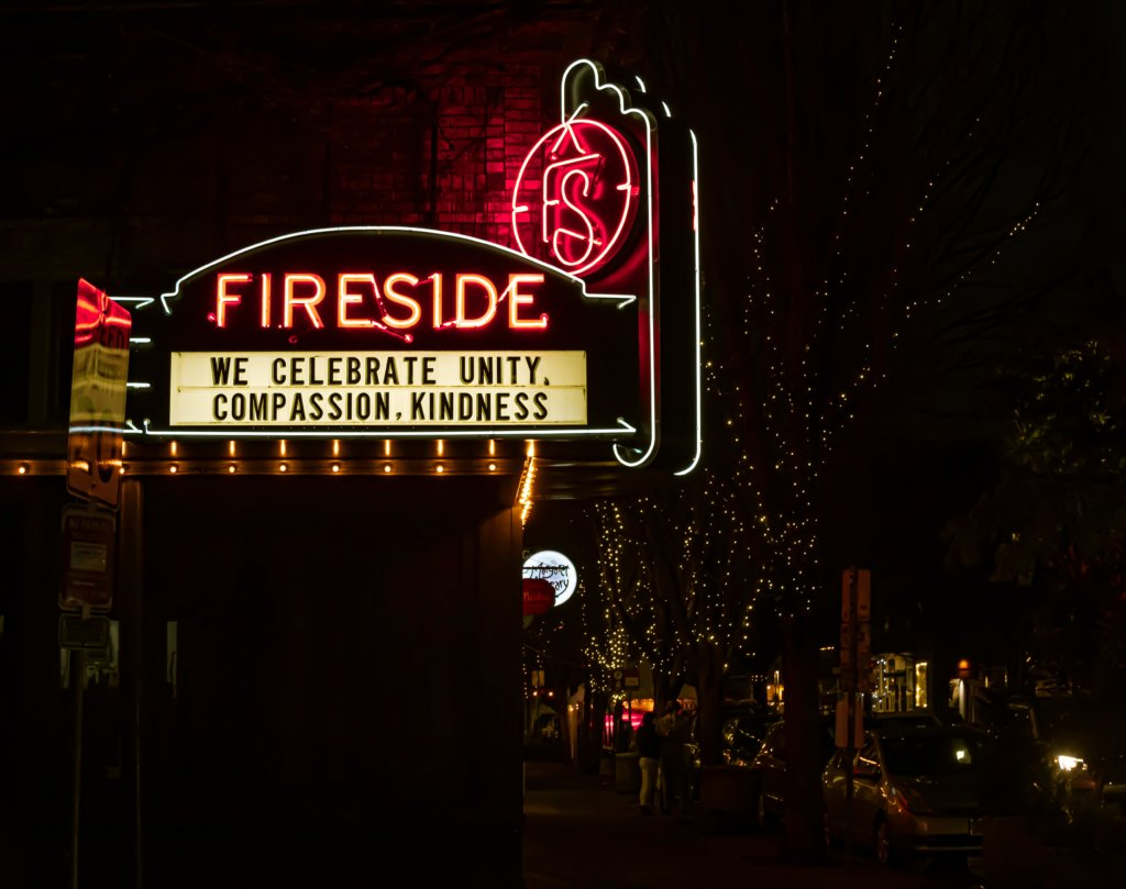 """A movie theater sign that says, """"We celebrate unity, compassion, kindness"""""""