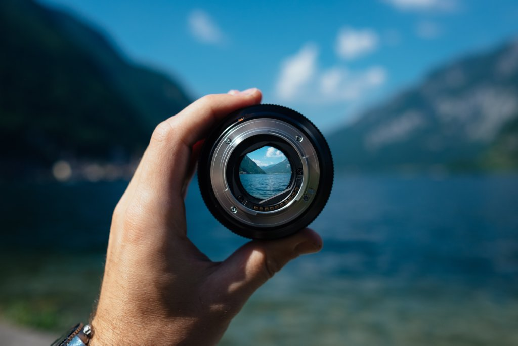 Looking through a focused lens at a valley lake