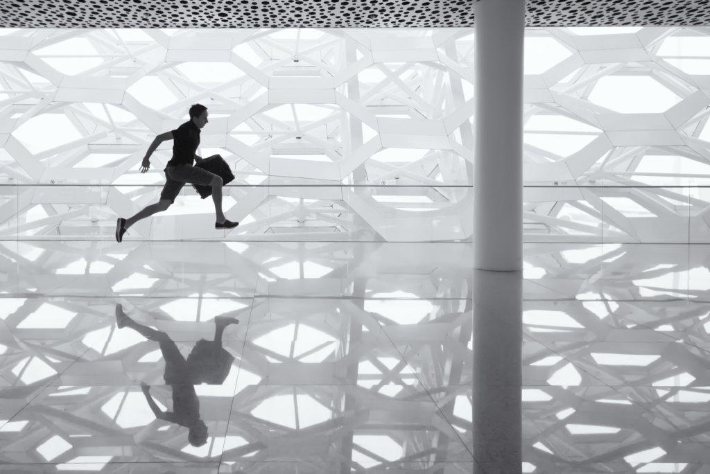 A man sprinting through an empty airport
