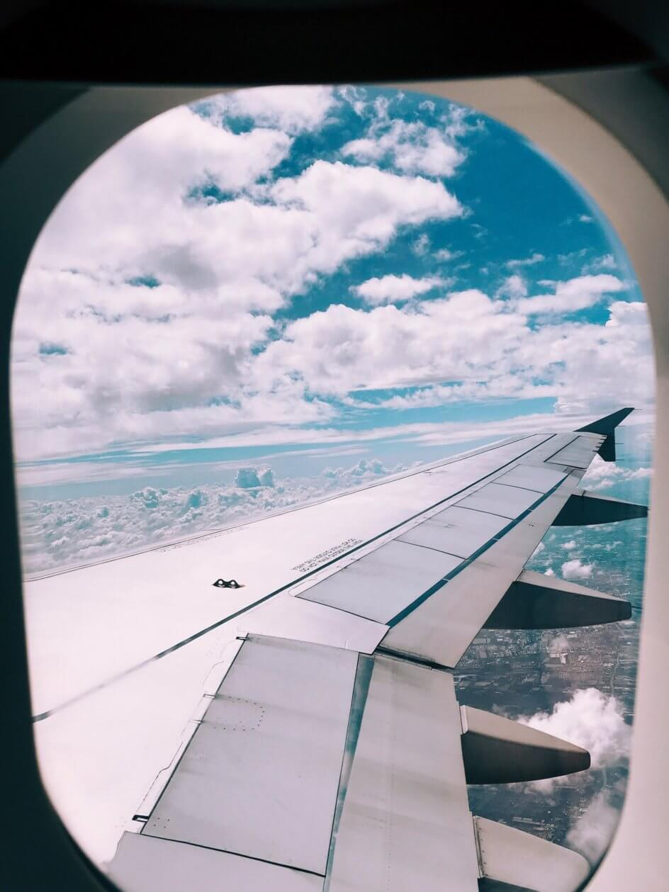 Looking out the window of a passenger jet