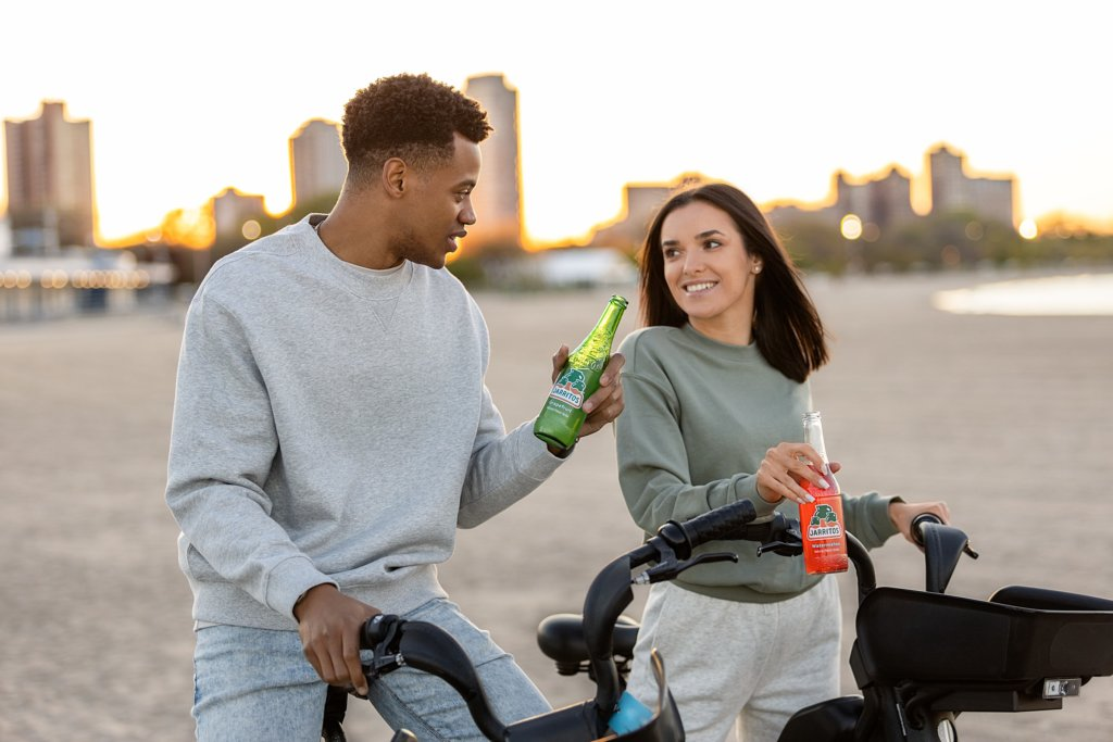 A man and woman sitting on bicycles and talking