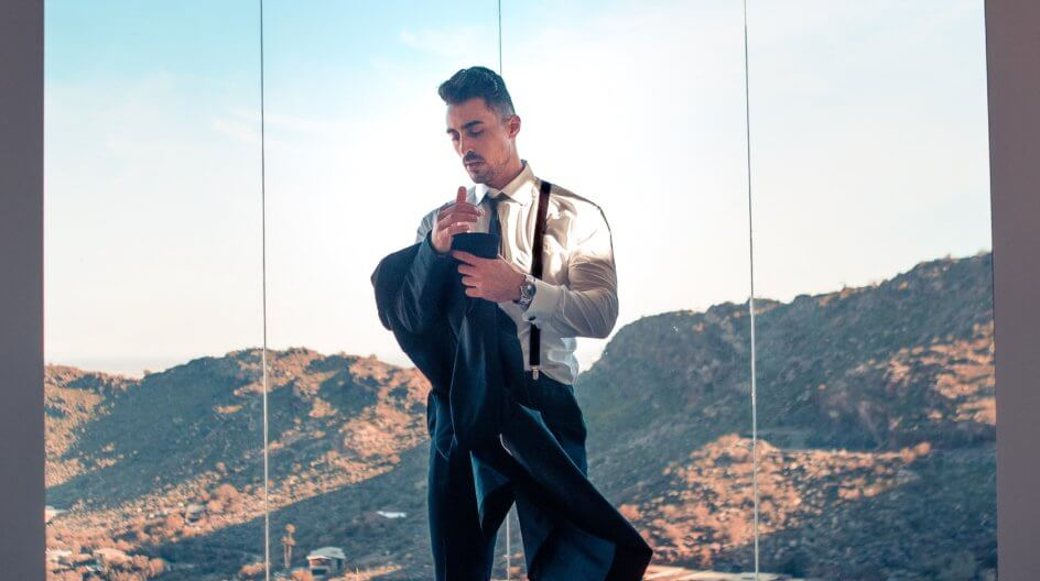 Man in suit standing in front of a great view