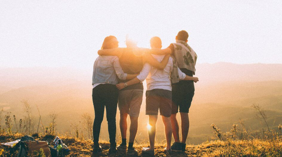 Four friends watching the sunset