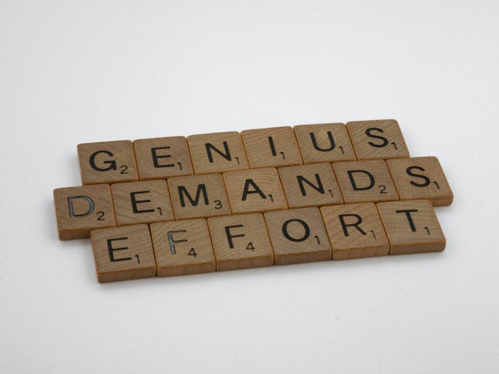 """Scrabble squares that spell """"Genius demands effort"""""""