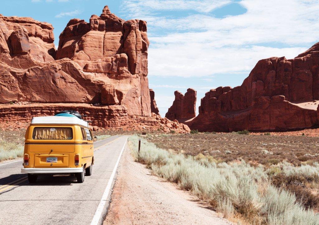 A van driving through a desert valley