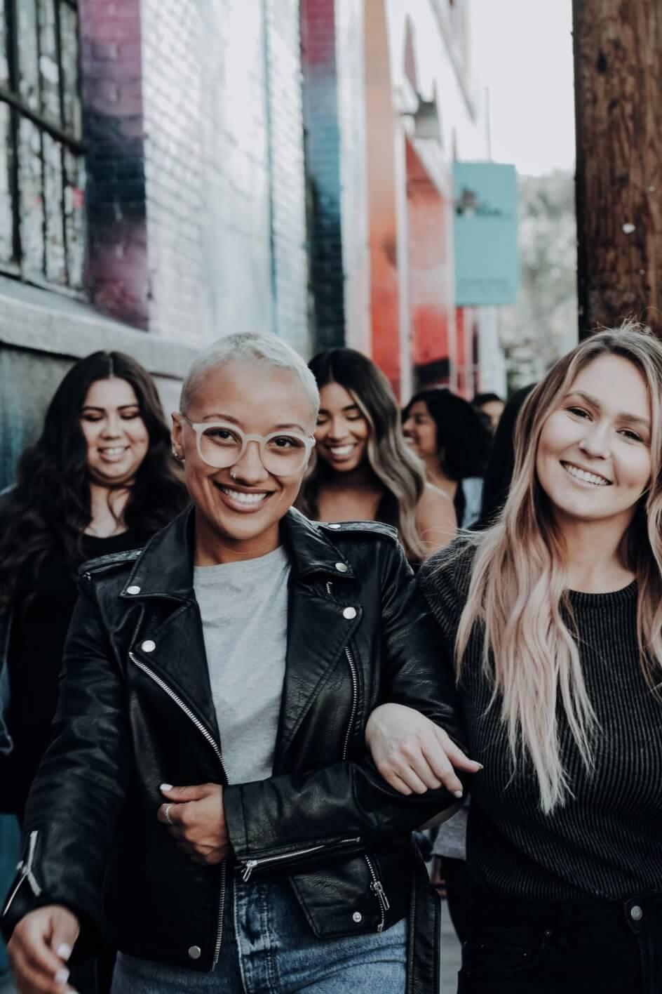 Group of smiling women walking toward camera