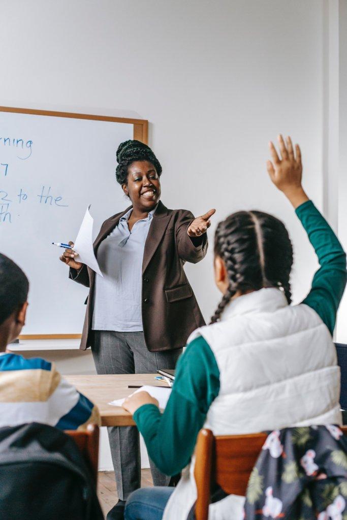 A female teacher calling on a student in class
