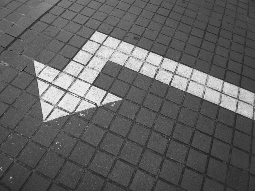 A white arrow painted on the ground